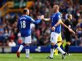 Wayne Rooney of Everton and Manchester United with Duncan Ferguson of Everton at the end of the Duncan Ferguson Testimonial match between Everton and Villarreal at Goodison Park on August 2, 2015