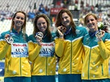Emma Mckeon, Emily Seebohm, Cate Campbell and Bronte Campbell of Australia pose during the medal ceremony for the Women's 4x100m Freestyle Relay on day nine of the 16th FINA World Championships at the Kazan Arena on August 2, 2015