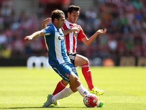 Victor Sanchez of Espanyol holds off pressure from Juanmi of Southampton during the pre season friendly match between Southampton and Espanyol at St Mary's Stadium on August 2, 2015