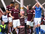 Sam Nicholson, of Hearts celebrates with team mate Morgaro Gomis after scoring during the Ladbrokes Scottish Premiership match between Heart of Midlothian FC and St Johnstone FC at Tynecastle Stadium on August 2, 2015