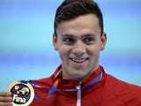 Great Britain's James Guy, silver, poses during the podium ceremony of the men's 400m freestyle swimming event at the 2015 FINA World Championships in Kazan on August 2, 2015