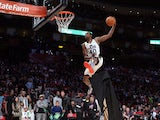 Jeremy Evans of the Utah Jazz jumps over a painting of himself in the final round during the Sprite Slam Dunk Contest part of 2013 NBA All-Star Weekend at the Toyota Center on February 16, 2013