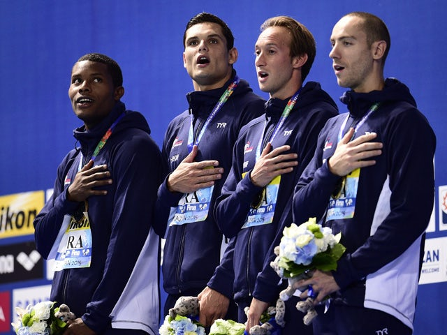France's Mehdy Metella, Florent Manaudou, Fabien Gilot and Jeremy Stravius pose during the podium ceremony of the men's 4x100m freestyle relay swimming event at the 2015 FINA World Championships in Kazan on August 2, 2015