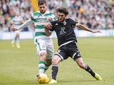 Nadir Ciftci of Celtic and Bedavi Huseynov of FK Qarabag in action during the UEFA Champions League Third Qualifying Round 1st Leg match between Celtic and FK Qarabag at Celtic Park on July 29, 2015