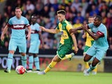 Ricky Van Wolfswinkel of Norwich City battles with Daniel Henry of West Ham United during the pre season friendly match between Norwich City and West Ham United at Carrow Road on July 28, 2015