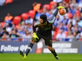 Arsenal's Czech goalkeeper Petr Cech rolls the ball out during the FA Community Shield football match between Arsenal and Chelsea at Wembley Stadium in north London on August 2, 2015