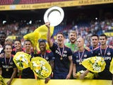 PSV Eindhoven's captain Luuk de Jong (C) shows the cup after winning the Dutch Super Cup football match between League champions Eindhoven and National Cup winner Groningen, in Amsterdam on August 2, 2015