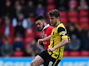 Sam Winnall of Barnsley holds off Derrick Williams of Bristol City during the Sky Bet League One match between Bristol City and Barnsley at Ashton Gate on March 28, 2015