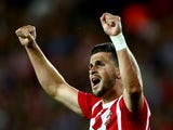 Shane Long of Southampton celebrates after scoring to make it 3-0 during the UEFA Europa League Third Qualifying Round 1st Leg match between Southampton and Vitesse at St Mary's Stadium on July 30, 2015