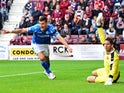Graham Cummins of St Johnstone celebrates after scoring during the Ladbrokes Scottish Premiership match between Heart of Midlothian FC and St Johnstone FC at Tynecastle Stadium on August 2, 2015