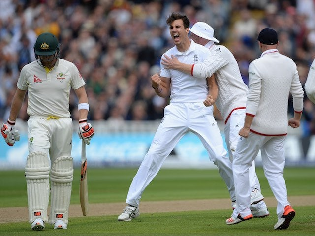 Steven Finn celebrates dismissing Steve Smith on day one of the Third Test of The Ashes on July 29, 2015