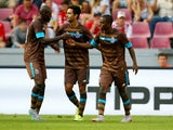 Maxi Pereira of Porto celebrates the second goal with Brahimi and Evandro of Porto during the Colonia Cup 2015 match between FC Porto and Stoke City FC at RheinEnergieStadion on August 2, 2015