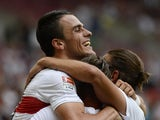 Stuttgart's Serbian midfielder Filip Kostic celebrates with teammates scoring during the friendly football match between VfB Stuttgart and Manchester City in Stuttgart, southern Germany, on August 1, 2015