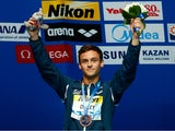 Bronze medalist Tom Daley of Great Britain poses with the medal won in the Men's 10m Platform final on day nine of the 16th FINA World Championships at the Aquatics Palace on August 2, 2015