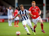 Callum McManaman of West Brom holds off Reece Flanagan of Walsall during the Pre-Season Friendly between Walsall and West Bromwich Albion at Banks' Stadium on July 28, 2015
