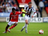 Callum McManaman of West Brom holds off Rico Henry of Walsall during the Pre-Season Friendly between Walsall and West Bromwich Albion at Banks' Stadium on July 28, 2015