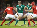 Andrew Trimble of Ireland takes on Tyler Morgan and Eli Walker (L) during the International match between Wales and Ireland at the Millennium Stadium on August 8, 2015