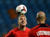 Luxembourg's forward Aurelien Joachim heads the ball during a training session at the Cidade de Coimbra stadium in Coimbra, central Portugal, on October 14, 2013