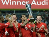 Bayern Munich's Chilean midfielder Arturo Vidal and his team-mates celebrate with the trophy after the Audi Cup final football match Real Madrid vs FC Bayern Munich in Munich, southern Germany, on August 5, 2015