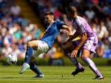 Jon Toral of Birmingham looks to pass under pressure from Michael Hector of Reading during the Sky Bet Championship match between Birmingham City and Reading at St Andrews Stadium on August 8, 2015