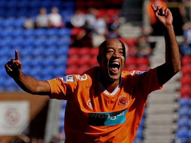 Alex Baptiste of Blackpool celebrates scoring his team's fourth goal during the Barclays Premier League match between Wigan Athletic and Blackpool at the DW Stadium on August 14, 2010