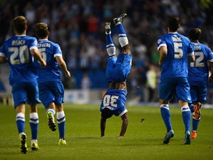 Kazenga LuaLua of Brighton celebrates after scoring the first goal of the season during the Sky Bet Championship match between Brighton & Hove Albion and Nottingham Forest at Amex Stadium on August 7, 2015
