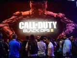Gaming fans wait in line to play Call of Duty Black Ops III at E3 - the Electronic Entertainment Expo - an annual video game conference and show at the Los Angeles Convention Center on June 16, 2015