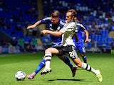 Fulham defender Lasse Vigen Christensen challenges Cardiff striker Anthony Pilkington during the Sky Bet Championship match between Cardiff City and Fulham at Cardiff City Stadium on August 8, 2015