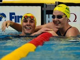 Australia's Cate Campbell (R) and Bronte Campbell (L) react at the end of a preliminary heat of the women's 100m freestyle swimming event at the 2015 FINA World Championships in Kazan on August 6, 2015
