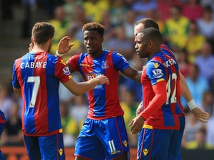 Wilfried Zaha of Crystal Palace celebrates scoring his team's first goal with his team mate during the Barclays Premier League match between Norwich City and Crystal Palace at Carrow Road on August 8, 2015