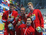 Gold medalists Daniel Wallace, Robert Renwick, Calum Jarvis and James Guy of Great Britain pose during the medal ceremony for the Men's 4x200m Freestyle Relay final on day fourteen of the 16th FINA World Championships at the Kazan Arena on August 7, 2015