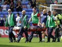 Will Hughes of Derby County is stretchered off the field after receiving an injury during the Sky Bet Championship match between Bolton Wanderers and Derby County at the Macron Stadium on August 8, 2015