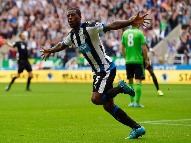 Georginio Wijnaldum of Newcastle United celebrates scoring their second goal during the Barclays Premier League match between Newcastle United and Southampton at St James' Park on August 9, 2015