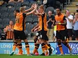 Sam Clucas of Hull City celebrates scoring their first goal during the Sky Bet Championship match between Hull City and Huddersfield Town at KC Stadium on August 8, 2015