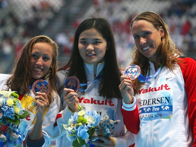 Bronze medalists Jessica Vall (L) of Spain, Rikke Moller Pedersen (R) of Denmark and Jinglin Shi (C) of China pose during the medal ceremony for the Women's 200m Breaststroke on day fourteen of the 16th FINA World Championships at the Kazan Arena on Augus