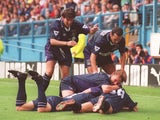 Jurgen Klinsmann of Tottenham is mobbed by teammates after scoring a goal during the FA Carling Premier League match between Sheffield Wednesday and Tottenham Hotspur at Hillsborough on August 20, 1994