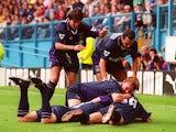 Jurgen Klinsmann of Tottenham is mobbed by teammates after scoring a goal during the FA Carling Premier League match between Sheffield Wednesday and Tottenham Hotspur at Hillsborough on August 20, 1994