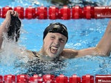 USA's Katie Ledecky celebrates winning and setting a new world record in the final of the women's 800m freestyle swimming event at the 2015 FINA World Championships in Kazan on August 8, 2015