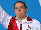 Silver medallist Lauren Quigley of England poses during the medal ceremony for the Women's 50m Backstroke Final at Tollcross International Swimming Centre during day six of the Glasgow 2014 Commonwealth Games on July 29, 2014