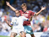 Giuseppe Bellusci (L) of Leeds United challenges Jelle Vossen of Burnley during the Sky Bet Championship match between Leeds United and Burnley at Elland Road on August 8, 2015