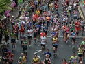Runners make their way through Canary Wharf during the Virgin Money London Marathon on April 26, 2015