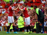 Bastian Schweinsteiger of Manchester United high fives with his team mate Michael Carrick during the Barclays Premier League match between Manchester United and Tottenham Hotspur at Old Trafford on August 8, 2015