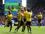 Miguel Layun (3rd L) of Watford celebrates scoring his team's first goal with his team mates during the Barclays Premier League match between Everton and Watford at Goodison Park on August 8, 201
