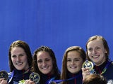 Team USA celebrates with the gold medal during the podium ceremony for the women's 4x200m freestyle relay swimming event at the 2015 FINA World Championships in Kazan on August 6, 2015