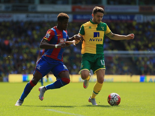 Wilfried Zaha of Crystal Palace and Robbie Brady of Norwich City compete for the ball during the Barclays Premier League match between Norwich City and Crystal Palace at Carrow Road on August 8, 2015