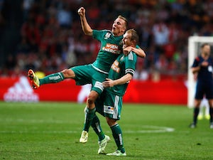 Ajax knocked out by Rapid Vienna