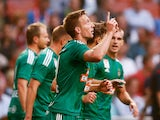 Robert Beric of Rapid Wien celebrates scoring his teams first goal of the game during the third qualifying round 2nd leg UEFA Champions League match between Ajax Amsterdam and SK Rapid Vienna held at Amsterdam ArenA on August 4, 2015
