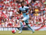 West Ham United's English defender Reece Oxford runs with the ball during the English Premier League football match between Arsenal and West Ham United at the Emirates Stadium in London on August 9, 2015