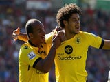 Rudy Gestede (C) of Aston Villa celebrates scoring his team's first goal with his team mates Gabriel Agbonlahor (L) and Carlos Sanchez (R) during the Barclays Premier League match between A.F.C. Bournemouth and Aston Villa at Vitality Stadium on August 8,