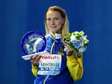 Sweden's Sarah Sjostrom poses with her world record award during the podium ceremony for the women's 100m butterfly swimming event at the 2015 FINA World Championships in Kazan on August 3, 2015
